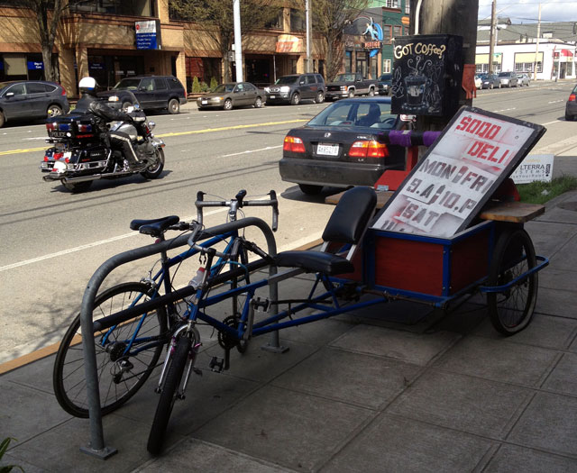 Parked by the SODO Deli delivery trike