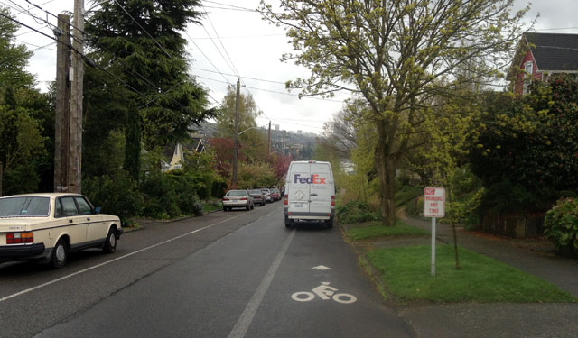 FedEx truck in the bike lane