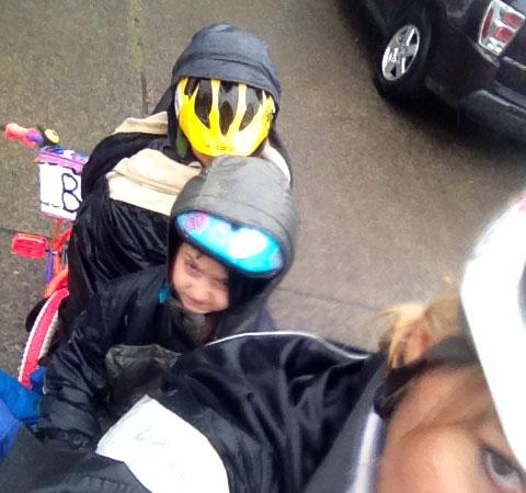 Hoods halfway on helmets
