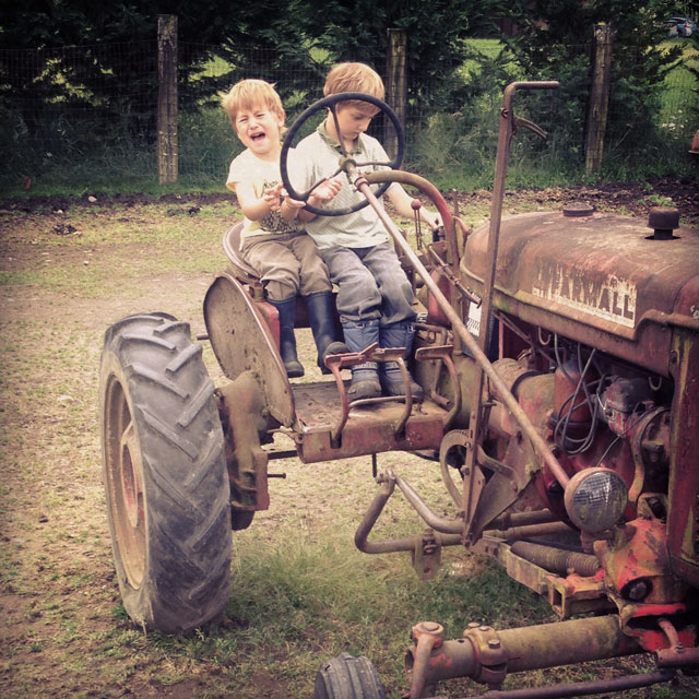 Two on a tractor, not happily