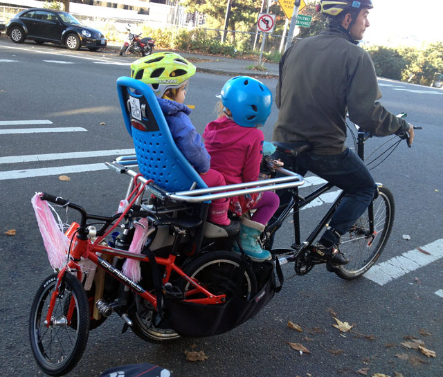 Tom towing two kid bikes