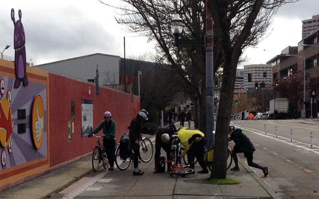 Critical Lasses fix a bike