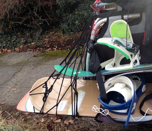 Cargo net snowboard cradle