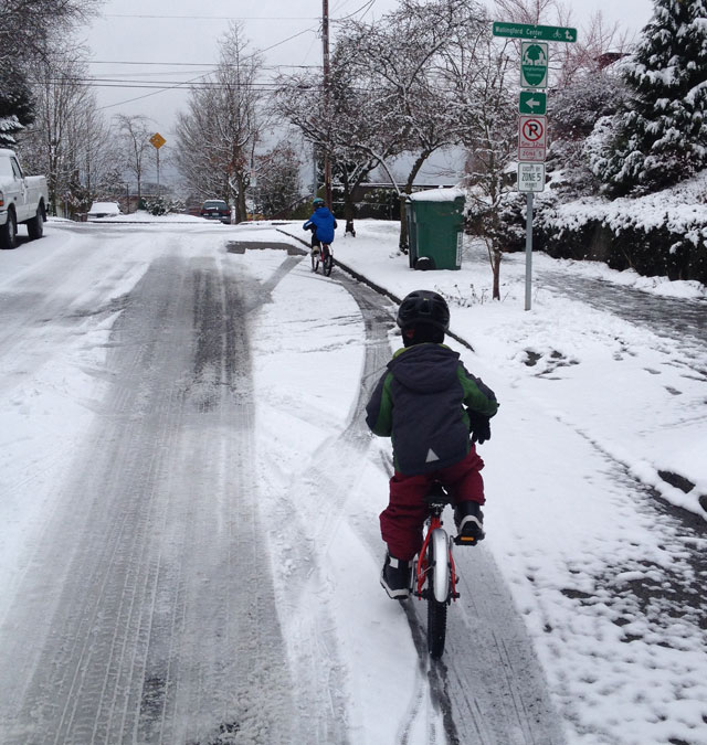 Kids riding in the snow
